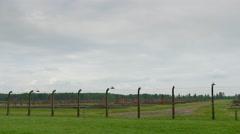 4K Auschwitz Birkenau, Field of Former Male Prison Barracks Buildings, Barb Wire Stock Footage