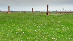 4K Chimneys Remains of Old Wooden Buildings at Auschwitz Birkenau, Barracks Stock Footage