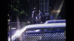 1965: outdoor scene children talking to an adult viewed from far NEW JERSEY Stock Footage