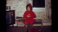 1965: little girl in red costume practices for performance NEW JERSEY Stock Footage