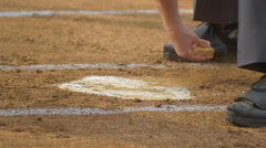 The umpire at a baseball game brushes off home plate, slow motion. Stock Footage