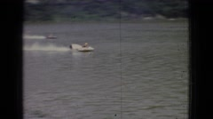 1965: speed boats are participating in the racing competition through the river Stock Footage