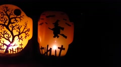Halloween candles, witch, castle, tree and ghost decorated lights, in a dark  Stock Footage