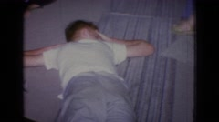 1965: footage of family sitting together in living room NEW JERSEY Stock Footage