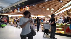 People shop at duty free boutiques at the International Airport Stock Footage