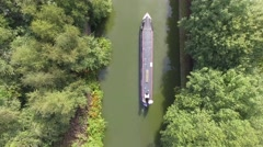 Aerial view following a barge on the canal. Stock Footage