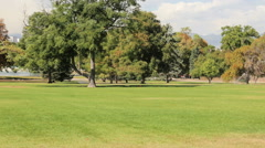 Sprinkles watering green lawn at the City Park in the Autumn. Stock Footage
