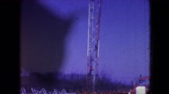 1966: setting up tower for oil drilling is very important work for these guys Stock Footage