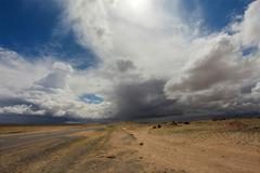 Storm clouds before rain in the Gobi Desert, Mongolia Stock Photos