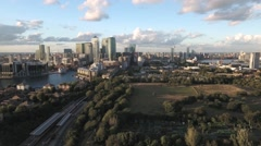 Aerial descending view of the financial district of the Docklands in London Stock Footage