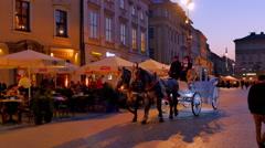 4K Horse Drawn Carriage, Tourist Main City Square Tourists, Krakow Poland Stock Footage
