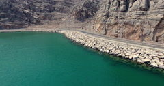Car approaching curve Musandam Sultanate of Oman Stock Footage