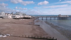 The beach and the pier in Worthing, Southern England Stock Footage