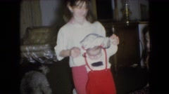 1966: an older sister helps a toddler walk across the living room floor ATHENS Stock Footage