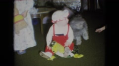 1966: cute child playing indoor near pet dog cuddling ATHENS OHIO Stock Footage