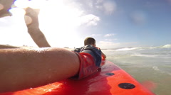 POV of a boy learning to surf at the beach. Stock Footage