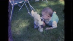 1966: baby playing happily in the garden ATHENS OHIO Stock Footage