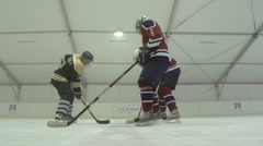 Ice hockey players in a face-off go for the puck, super slow motion. Stock Footage