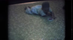 1966: baby learning to crawl ATHENS OHIO Stock Footage