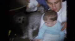 1966: a family is spending time in the living room of the house ATHENS OHIO Stock Footage