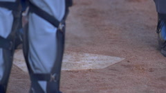 The umpire brushes off home plate at a little league baseball game, slow motion. Stock Footage