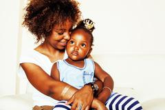 Adorable sweet young afro-american mother with cute little daugh Kuvituskuvat
