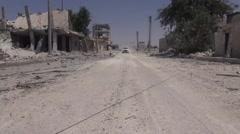 Syria, Kobani - October, 2016: Street car between destroyed houses Stock Footage