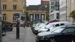 Cars parked on the street in Munich, Germany, Bavaria Stock Footage