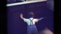 1966: little boy pulling clothes out of a drawer. ATHENS OHIO Stock Footage