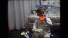 1966: little boy playing with it's toys. ATHENS OHIO Stock Footage