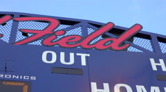 The scoreboard at a little league baseball game shows the score. Stock Footage