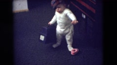 1966: a little baby with a hat attempting to walk ATHENS OHIO Stock Footage