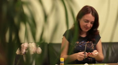 Woman Cuts Paper For Making Flowers With Slide Stock Footage