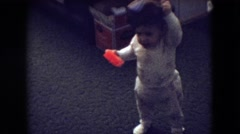1966: home video of a cute baby putting on a hat and falling down ATHENS OHIO Stock Footage
