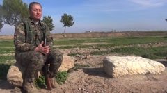 Syria - October 15, 2016:YPJ soldier speak and sit on a rock, SDF- Training camp Stock Footage