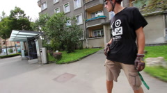 A young man longboard skateboarding downhill in a city. Stock Footage