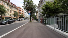 A young man longboard skateboarding downhill in a city, time-lapse. Stock Footage
