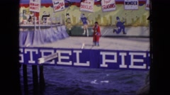 1966: joker's show on the deck besides the pool NEW JERSEY Stock Footage