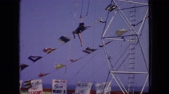 1966: trapeze woman performing on windy day NEW JERSEY Stock Footage