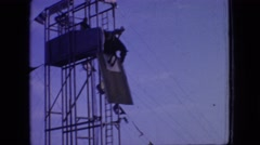 1966: a kid practicing for a horse jump into water from heights. NEW JERSEY Stock Footage