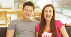 4k, Young attractive couple watching a comedy movie and laughing. Slow motion. Stock Footage