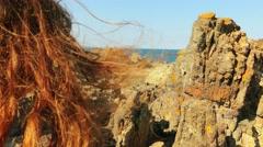 Little beautiful girl walks on a stone rocks Stock Footage