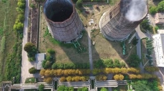Cooling tower of thermal power station HD aerial video. Flight over industrial Stock Footage