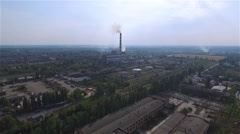 Flight over urban industrial landscape HD aerial video: thermal power station Stock Footage