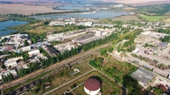 Flight over urban industrial area landscape HD aerial video: storage countryside Stock Footage