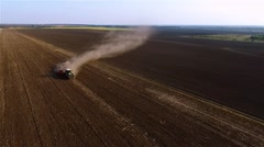 Cultivation soil farm equipment tractor plowing field harvesting HD aerial video Stock Footage