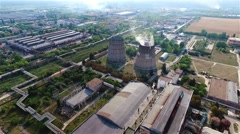 Cooling tower thermal power station HD aerial video. Flight over industrial area Stock Footage