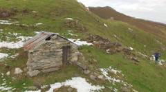 Aerial view of a trail runner and a small house. Stock Footage