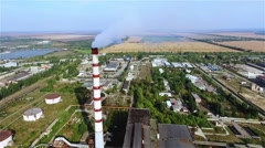 Flue-gas stack tower thermal power station HD aerial video. Industrial pollution Stock Footage