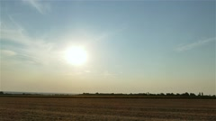 Sunset rural field landscape 4k time-lapse video. Sun moving in clear sky Stock Footage